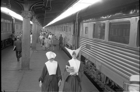 passengers_including_nuns_walking_near_trains-1